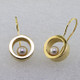 """These floating pearl earrings are modern and timeless. Classic circles in 14 karat Yellow Gold with 4.5mm very fine Akoya cultured Pearls, hanging on wires. Measure 1"""" long.  Designed, and created in our studio by the artist Stuart J."""