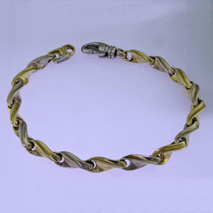 This beautiful twisted link two tone bracelet has an elegant, luxurious feel. Handcrafted in solid 14 karat yellow and white gold. Measures 7.5 inches long, and can be orderd in any size, or karat and color of gold, and platinum. How's that for options. This one, however, is ready for a wrist now.  Proudly crafted in the U.S.A.