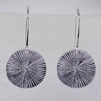 Beautiful spiral earrings in rhodium plated sterling silver. Dangling on wires, these stylish earrings measure 1 1/2 inches long.  Handmade in northern Spain.