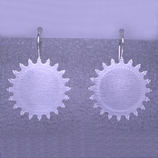 Playful and bright, these sunburst earrings are a delight to wear and they will make you smile. Crafted in Sterling Silver with a sunburst pattern, hanging on wires, and measuring 1 1/4 inches long.   Handmade in Istanbul, Turkey.