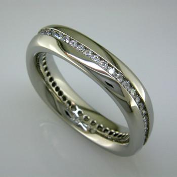 Modern man's diamond wedding ring - classy and very cool. Crafted in 14 karat White Gold, 6mm wide, with a continuous row of Ideal cut Diamonds totaling 3/4 carat. Squared shape and inside comfort fit to make this band the most comfortable it can be.  This diamond wedding ring is priced in 14k gold, and can be made in any karat or color of gold, and in platinum. Please allow 2 weeks to make it. It will be worth it!  Designed, and created in our studio by the artist Stuart J.