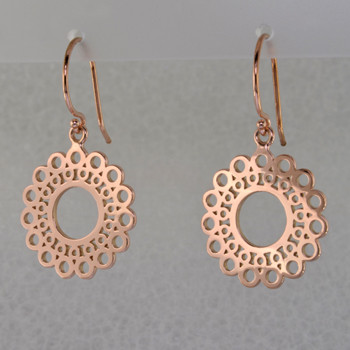 Designed, and created in our studio by the artist Stuart J., these airy earrings are fun for day or night. Handcrafted in 14 karat Rose Gold, hanging on wires. They measure 1 1/4 inches long.