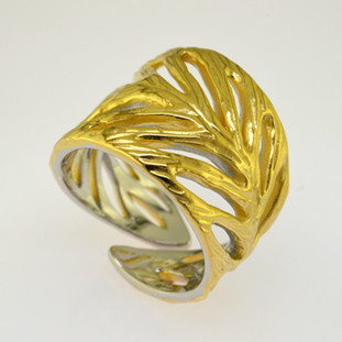 Everyday casual, or evening chic, you can't go wrong with this gold plated Sterling Silver leaf ring. Standard finger size is 81/2, but call us with your finger size and we will have it made just for you. Please allow 3 weeks to get your ring. Measures 3/4 inch wide.  Handmade in Northern Spain.