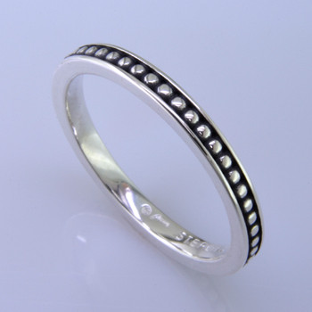 This cool, hip, and fun stackable ring is the start of your new collection. This ring will have many different looks when you stack it with other rings, or enjoy it alone in your everyday style. Hand finished in Sterling sliver with a beautiful ball design. Finger size 7. We will make this any size you need in about 10 days. Band measures 2.5mm wide.   Designed, and created in our studio by the artist Stuart J.  This ring is also shown with other gemstone colors and sizes, which are sold separately, and can be stacked with all other rings in our stackables collection. You can also stack it with any ring you like. There are no rules. Call us with your favorite color, and we will customize this Just For You.
