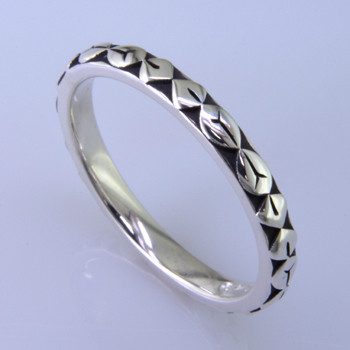 This cool, hip, and fun stackable ring is the start of your new collection. This ring will have many different looks when you stack it with other rings, or enjoy it alone in your everyday style. Hand finished in Sterling sliver with a beautiful leaf design. Finger size 7. We will make this any size you need in about 10 days. Band measures 2.5mm wide.   Designed, and created in our studio by the artist Stuart J.  This ring is also shown with other gemstone colors and sizes, which are sold separately, and can be stacked with all other rings in our stackables collection. You can also stack it with any ring you like. There are no rules. Call us with your favorite color, and we will customize this Just For You.