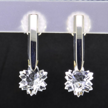 What's better than one sparkling snowflake? Two, of course. One for each ear. And you can turn up the heat, because these snowflakes won't melt. Exclusively ours, each colorless topaz snowflake is custom cut just for us, in Canada, by master gem cutters. Each snowflake measures 8mm, and dangles in a sterling silver Piercette® setting on a post, measuring 1 inch long.  Designed, and created in our studio by the artist Stuart J.  A Piercette® is a patented method of setting, with a gemstone that moves. The gem is set so that it swivels with every movement of the wearer, exhibiting extra sparkle.