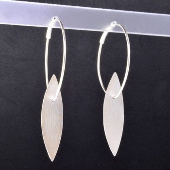 Fun, everyday open leaf hoop earrings, handmade in Sterling Silver, and a smooth matte finish. Measuring 2 inches long.    Designed and handmade in Istanbul, Turkey.