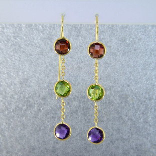 Fun dangles you can wear day or night. 14 karat yellow gold 3 stone dangle with amethyst, peridot, and garnet gemstones set delicately in simple bezels and hanging on wires. Measure 2 inches long.