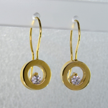 These floating diamond earrings are modern and timeless. Classic circles in 14 karat yellow Gold with .20ct. T.W. Ideal cut Diamonds, hanging on wires. Measure 3/4 inch long.  Designed, and created in our studio by the artist Stuart J.