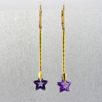 You can wish upon a star with these beautiful star earrings. Exclusively ours, each amethyst gemstone star is custom cut just for us, in Canada, by master gem cutters who know what stars look like. Each star measures 8mm, and dangles from the bottom of 14 karat yellow gold teardrop Piercette,and dangling from a thin gold snake chain wire. These gorgeous earrings measure 1 3/4 inch long, and have lever backs. They are available with Colorless Topaz,and Citrine.  Other colors could take up to 8 weeks delivery, but ask anyway!  Designed and handmade by the artist Stuart J.  A Piercette® is a patented method of setting, with a gemstone that moves. The gem is set so that it swivels with every movement of the wearer, exhibiting extra sparkle.