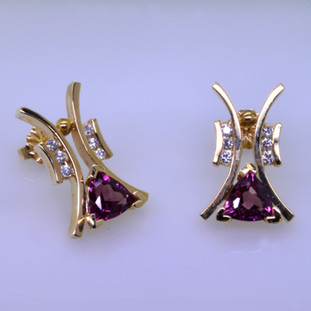 """Striking, modern diamond earrings in 14 karat yellow gold with .18ct. T.W. of ideal cut diamonds, and 1.73ct. of rhodolite garnet trillian gemstones with posts.  These elegant diamond earrings measure 3/4"""".   Designed, and created in our studio by the artist Stuart J."""