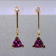 """Fun and modern, these earrings dazzle for day or night. Hand crafted in 14 karat yellow gold with sparkling 6mm rhodolite garnet trillian gemstones and .10ct. of ideal cut diamonds hanging on posts.. Earrings measure 1"""" long.    Designed, and created in our studio by the artist Stuart J."""