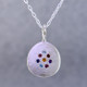 """This sweet pendant shimmers when you wear it. Beautiful sterling silver medallion sprinkled with aquamarine,ruby,blue sapphire,amethyst,pink tourmaline, and blue zircon gemstones set in a starburst pattern, with a glowing citrine in the center, hanging on a 1.4mm oval sterling silver cable chain. 18"""" long.    Wear it as a birthstone pendant too, and customize it just for you.  Call for prices on your special birthstones. Special orders will take 2-3 weeks  Designed and created in our studio by the artist Stuart J."""