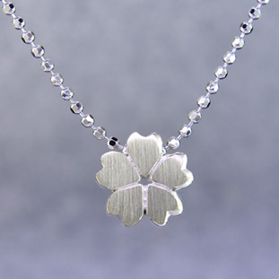 What's your story? Begin with this Little cherry blossom solid Sterling Silver pendant. Wear it alone, with other pendants , or layered with other necklaces. Comes with a sterling silver ball chain, 16 inches long. The pendant measures 1/4 inch long. Too cute!  Signified by a feminine sensibility and optimistic charm, Alex Woo's Little Icon Collections reinvent familiar symbols from the world around us into fresh and expressive designs.  Designed and handcrafted by Alex Woo in New York City.