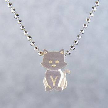 What's your story? Begin with this Little Kitten, solid Sterling Silver pendant. Wear it alone, with other pendants, or layered with other necklaces. Comes with a sterling silver ball chain, 16 inches long. The pendant measures 1/4 inch long. Too cute!  Signified by a feminine sensibility and optimistic charm, Alex Woo's Little Icon Collections reinvent familiar symbols from the world around us into fresh and expressive designs.  Designed and handcrafted by Alex Woo in New York City.