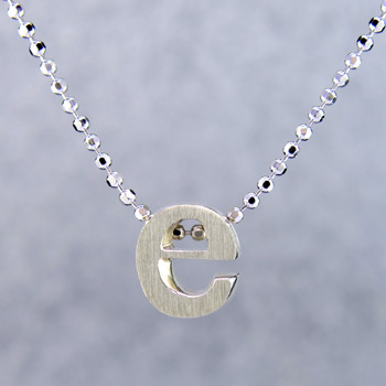 "What's your story? Begin with this Little ""e"" initial, solid Sterling Silver pendant. Wear it alone, with other pendants, or layered with other necklaces. Comes with a sterling silver ball chain, 16 inches long. The pendant measures 1/4 inch long. Too cute!  Signified by a feminine sensibility and optimistic charm, Alex Woo's Little Icon Collections reinvent familiar symbols from the world around us into fresh and expressive designs.  Designed and handcrafted by Alex Woo in New York City."