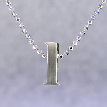 """What's your story? Begin with this Little """"L"""" initial, solid Sterling Silver pendant. Wear it alone, with other pendants, or layered with other necklaces. Comes with a sterling silver ball chain, 16 inches long. The pendant measures 1/4 inch long. Too cute!  Signified by a feminine sensibility and optimistic charm, Alex Woo's Little Icon Collections reinvent familiar symbols from the world around us into fresh and expressive designs.  Designed and handcrafted in our studio."""