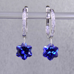 What's better than one succulent flower? Two, of course. One for each ear. Exclusively ours, each chatham created blue sapphire flower is custom cut just for us by master gem cutters who know what flowers look like. Each flower measures 8mm, and dangles from the bottom of a 14 karat white gold diamond top, glistening with .09ct. T.W. of ideal cut diamonds. These gorgeous earrings measure 1 inch long, and  hang from white gold lever backs. They are available with a variety of sapphire colors.  Other colors could take up to 8 weeks delivery, but ask anyway!  Designed and handmade by the artist Stuart J.  A Piercette® is a patented method of setting, with a gemstone that moves. The gem is set so that it swivels with every movement of the wearer, exhibiting extra sparkle.   Chatham Gemstones are also available in Ruby, Sapphire, and Alexandrite.                                                                                                                                                                                                                                                                             Chatham® Created Gemstones are grown in carefully controlled laboratory conditions. They are chemically and optically identical to their natural counterparts, yet cost much less. Because the environment in which they are grown is controlled, the imperfections often found in natural gemstones, are absent in Chatham® Created Gemstones. Because of this, and superior cutting, Chatham® gems exhibit the color and sparkle of the finest natural gems. Each one comes with a Certificate of Authenticity, and a Lifetime Warranty.