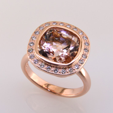 Modern and timeless morganite halo diamond ring, thoughtfully crafted in  14 karat rose gold will light up the room! Set with .24 carat total weight of super sparkly Ideal cut diamonds, and an incredible 4.10 carats natural morganite gemstone. This morganite and diamond ring has no prongs to worry about, and can be dressed up or down to go with any outfit.  A truly spectacular piece, that will never be out of style!  Designed, and created in our studio by the artist Stuart J.