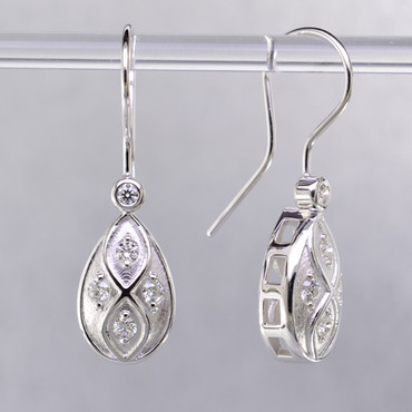 You will feel captivated by the feel of modern and vintage in these elegant drop earrings. 14 karat white gold with .30 carats of sparkling ideal cut diamonds. These beautiful diamond earrings measure 1/2 inch long, and dangle from hand-made wires.  Designed and created in our studio by the artist Stuart J.