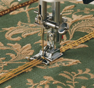 The 3-way Cording foot will hold one, two or three fine cords or threads. Because they are attached to the foot, the required design can be easily followed and the cords are perfectly places. A variety of utility or decorative stitch can be sewn over the cords to couch them onto base fabrics. The choice of cord, thread, and stitch are all contributory factors to the final effect.