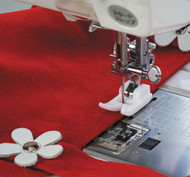 The Ultraglide foot is molded from a special resin allowing easier sewing of fabrics that may otherwise stick to the standard metal foot such as ultra suede, faux leather and plastic.