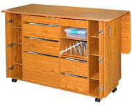 """Model Number: 7600 - New for 2017 > New for 2017 Space Saver Design:  2016 Full Line Brochure > View/Print Flyer > Available in Sunset Oak, Solid White or White with Oak trim Features: Six adjustable shelves Included back shelf Melamine (smooth) mar-resistant surface 2.5mm rounded edge banding Rounded corners for safety 7 Drawers on nylon rollers with stops Large work surface Hinged drop leaf cutting table installed with locking casters on dual supports Sturdy construction with steel connectors Easy roll lockable casters """"NEW"""" Bi-fold swing away doors Pull out thread storage shelf"""