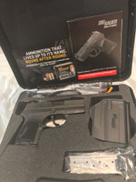 USED SIG SAUER 290RS 9MM COMES WITH HOLSTER CASE AND TWO MAGAZINES