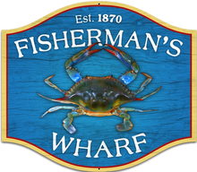 Photo of FISHERMANS WARF, PLASMA CUT SIGN SHAPED SIGN, HAS A BLUE CRAB IN THE CENTER, FISHERMAN'S ACROSS THE TOP AND WARF ACROSS THE BOTTOM, SIGN HAS RICH COLORS AND GREAT GRAPHICS