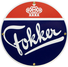 Photo of FOKKER PORCELAIN SIGN, RED, WHITE AND BLUE COLORS WITH A CROWN AT THE TOP AND FOKKER ACROSS THE MIDDLE AND BOTTOM.  NICE DETAILS RICH COLORS