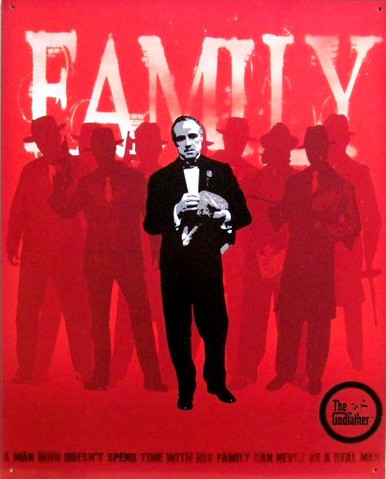 GODFATHER SIGN SHOWS THE GODFATHER HOLDING HIS CAT AND HIS FAMILY AS BACKGROUND