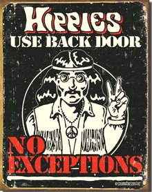 HIPPIES USE BACK DOOR SIGN