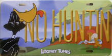 "DAFFY DUCK LICENSE PLATE  NO HUNTIN""  MEASURES 12"" X 6""  WITH SLOTS FOR EASY MOUNTING"
