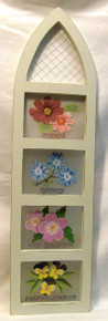 """FOUR FLOWERS IN CHURCH WINDOW SHAPED WOOD FRAME MEASURES 6 1/2"""" X 3/8"""" X 23 1/2"""""""