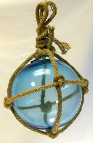 "SMALL LIGHT BLUE GLASS FLOAT  MEASURES 5"" X 5"" X 10"" WITH ROPE"
