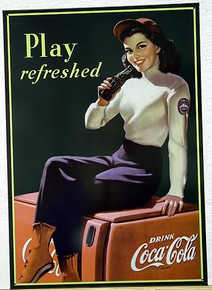Photo of COKE COOLER GIRL SITTING ON AN OLD COCA-COLA COOLER IS JUST OFF THE SKI SLOPES LOOKING FOR REFRESHMENT. NOSTALGIC SIGN DATES TO AROUND THE 40'S