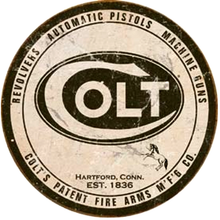 Photo of COLT ROUND SIGN IS AN AD FOR REVOLVERS, AUTOMATIC PISTOLS AND MACHINE GUNS WITH AN OLD TIME LOOK