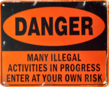 Photo of DANGER ILLEAGLE ACTIVITIES SIGN