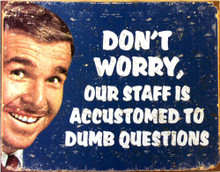 Photo of DUMB QUESTIONS, DON'T WORRY, OUR STAFF IS ACCUSTOMED TO DUMB QUESTIONS SIGN. FADED COLORS AND GRAPHICS MAKE THIS SIGN LOOK LIKE IT CAME FROM THE 60'S