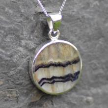 Plain round Derbyshire blue John pendant