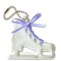 Figure skate soft reflector with lavender satin lace and metal ball chain attachment. Width 6.5cm, Height 6cm (2 5/8 by 2 3/8 inches).