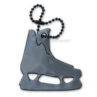 Hockey skate silvery black soft reflector with metal ball chain attachment. Width 6.5cm, Height 6 cm (2 5/8 by 2 3/8 inches).