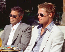 This is an image of 250132 George Clooney and Brad Pitt Photograph & Poster