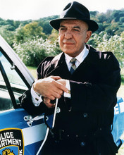 This is an image of Photograph & Poster of Telly Savalas 285073