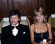 This is an image of Photograph & Poster of Charles Bronson and Jill Ireland 287063