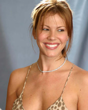 This is an image of Photograph & Poster of Nikki Cox 287300