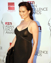 This is an image of Photograph & Poster of Tia Carrere 287873