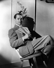 This is an image of Photograph & Poster of Franchot Tone 198361