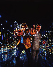 This is an image of 280833 Nick Nolte as Jack Cates and Eddie Murphy as Reggie Hammond in 48 Hrs.