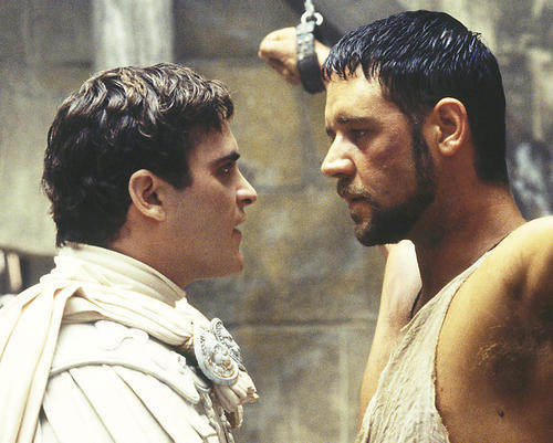 This is an image of 242069 Russell Crowe & Joaquin Phoenix Photograph & Poster